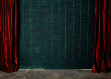 Red curtains on brick wall background Stock Photography