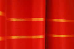 Red curtains detail. Closeup of red curtains made of satin fabric Stock Photo