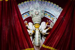 Red curtains getting revealing durga idol for worship.  Stock Images