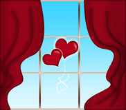 Red curtains and heart-shaped baloons Stock Images