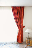 Red curtains in a hotel room Royalty Free Stock Images