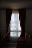 Red curtains in a hotel room Stock Image