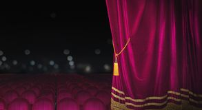 The red curtains are opening for the theater show. The red curtains of the stage are opening for the theater show royalty free stock images
