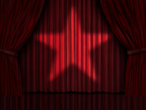 Red Curtains Star. Red curtains with a star light shinning on the velvet drapes on a stage as a symbol of cinema and theatre acting performance entertainment or Stock Photography