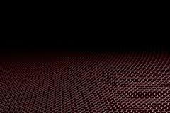 Red curve metallic mesh on black background. Stock Image