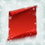 Red, curved, paper banner on winter background. Royalty Free Stock Image