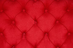 Red Cushion. Closeup of a red cushion with buttons royalty free stock images