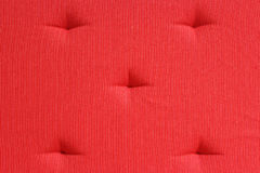 Red Cushion. Close up of a red cushion Royalty Free Stock Photography