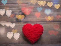 Red cushion heart shape on wood background royalty free stock photo