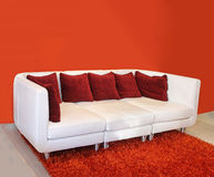 Red cushion sofa Stock Photography