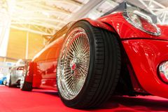 Red custom car in a showroom. With sunlight Stock Images