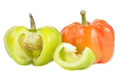 Red and Cut Green Bell Peppers Royalty Free Stock Images