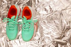 Tennis shoes in studio. Red, cyan, white pair of new tennis shoes in studio shot over reflective white background. Directly from above royalty free stock photos