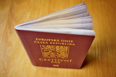Red Czech passport on the wooden surface with a state symbol (lions and eagles). And captions Czech Republic and European Union in Czech language Stock Photos