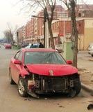 Red damaged car. Damaged red car at the street Stock Photos