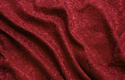 Red damask brocade fabric. Luxurious red brocade fabric with decorative damask pattern royalty free stock photography