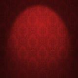 Red damask wallpaper. Illuminated from a spotlight royalty free illustration