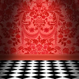 Red Damask Wallpaper With Black & White Checkerboard Tile Floor. Dramatic room with red flocked damask wallpaper and black and white checkerboard floor Stock Photo