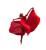 Red dancer. Gorgeous young flying dancer wearing red dress Stock Photos