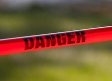 Red Danger Tape. Red danger caution tape up close royalty free stock image