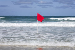 Red dangerous swimming warning Royalty Free Stock Photography