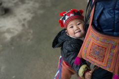 Red Dao child in Sapa, Vietnam. Sapa, Vietnam - February 13, 2015: Red Dao child in Ta Phin village outside Sapa. Sapa is famous for its rugged scenery and its Royalty Free Stock Photos