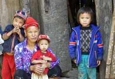Red Dao People of Vietnam. LACH MAN VILLAGE, VIETNAM - OCTOBER 25: Unidentified woman of the Red Dao People sitting with her children on October 25, 2014 in Lach Royalty Free Stock Photos