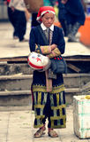 Red Dao woman at market. Woman from the Red Dao tribe at a local market in Sa Pa, Vietnam Royalty Free Stock Photo