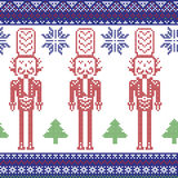 Red , dark blue , and green Nordic Christmas  pattern with nutcracker soldier , Xmas trees , snowflakes, stars, snow decorative or Royalty Free Stock Image