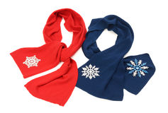Red and dark blue scarf decorated with snowflakes. Stock Photos