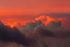 Red and dark clouds. On sunset sky Stock Photo