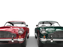 Red and dark green metallic vintage cars - front view - cut shot Stock Photography