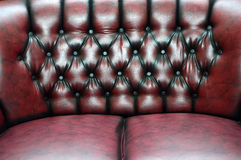 Red dark leather seat upholstery. Texture and pattern of red dark leather seat upholstery Stock Photos