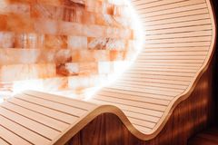Red, dark sauna with ergonomic cocoon with a salt wall. Close-up Stock Photo