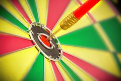 Red dart. Arrow on center of dartboard, metaphor as target success or business goal achievement concept Royalty Free Stock Image