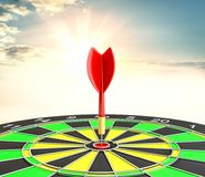 Red dart arrow hit target point center. And sunrise background. 3d illustration Stock Images