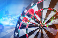 Red dart arrow hitting in the target Royalty Free Stock Images