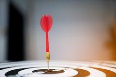 Red dart arrow hitting in the target center Stock Photos