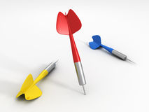 Red dart arrow with shadow sticking in the ground. And lying others Stock Photo