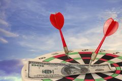 Red Dart Arrow on Target dartboard with Blue Sky royalty free stock images