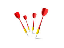 Red Dart Arrows. Red plastic dart arrows hit the ground, isolated on white background Royalty Free Stock Photography