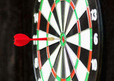 Red Dart in Bulls Eye Stock Photo