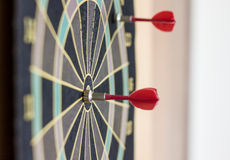 Red dart on the bulls eye Stock Images