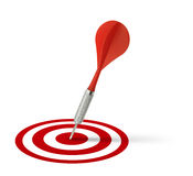 Red dart hitting target Royalty Free Stock Images