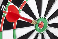 Red dart hitting a target Stock Photography