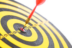Red dart hitting a target Stock Photo
