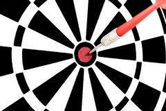 Red dart hitting a target Royalty Free Stock Image