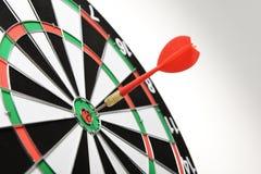 Red dart hitting target center Stock Photos