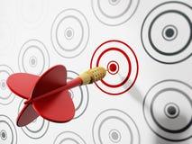 Red dart hitting target. Red dart hitting red target among gray ones Royalty Free Stock Images