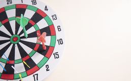 Red dart on the middle dart board on the wall. Right on target concept using dart in the bullseye on dartboard business success concept stock illustration